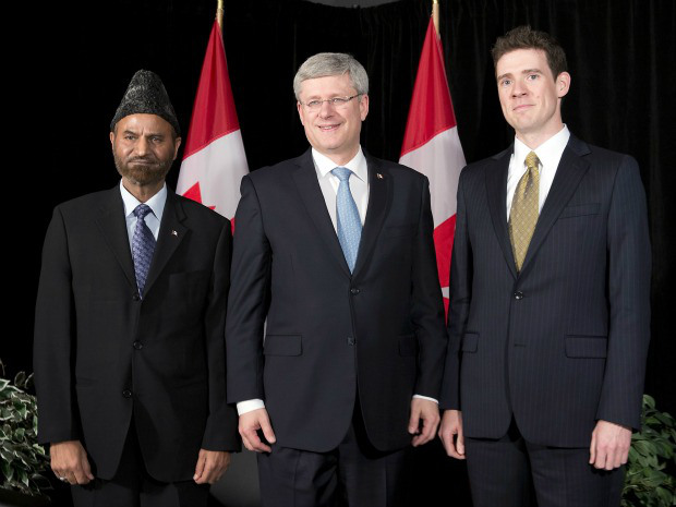 Prime Minister Stephen Harper (center) with Andrew Bennett the new Ambassador and Lal Khan Malik, National President of Ahmadiyya Muslim Community, Canada